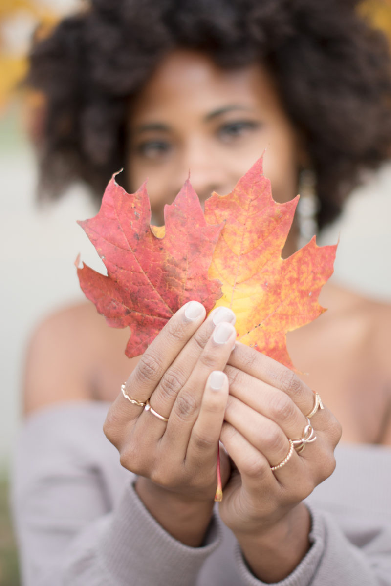 holding red fall leaves